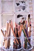 image of bristle brush  - Paintingdrawing and sketching tools. Graphite and charcoal pencils for fine art in the middle and blending stumps or tortillons for blending pencil drawings to the left. Bouquet of colorful brushes of different types and sizes to the right. ** Note: Shal - JPG