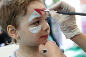 stock photo of face painting  - Boy with painting face at the amusement park - JPG