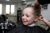picture of barbershop  - Portrait of a laughing child at the barbershop - JPG