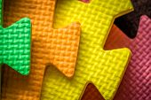 stock photo of joining  - Close up of a joining parts of the colorful pieces of a children - JPG