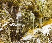 stock photo of icicle  - Icicles and rocks in the mountain closeup - JPG