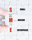 image of enterprise  - Hand of a business man completing the puzzle with the last missing piece - JPG