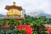 stock photo of hong kong bridge  - The Golden pavilion and red bridge in the Nan Lian Garden near the Chi Lin Nunnery a famous landmark in Hong Kong - JPG