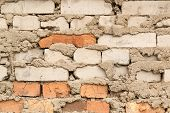 stock photo of ooze  - Bodged brick wall with messy loose cement - JPG