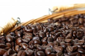 picture of coffee coffee plant  - roasted coffee beans in brown basket soft focus focus on coffee