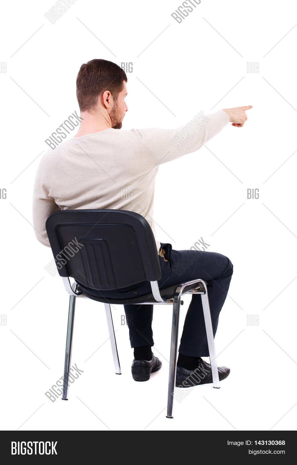 Man sitting in chair side - Back View Of Young Business Man Sitting On Chair And Pointing Rear View People Collection