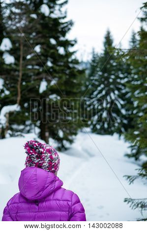 Woman hiking in white winter forest woods. Recreation fitness and healthy lifestyle outdoors in nature. Motivation and inspirational winter landscape. Walking exercise outdoor in winter environment.