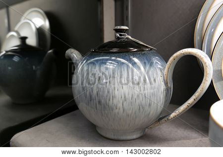 Burnaby, BC, Canada - July 29, 2016 : Display colorful teapot for sale in utensils section inside The bay store