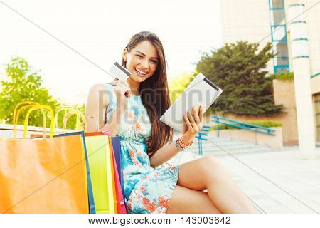 Young women buying online through a digital tablet