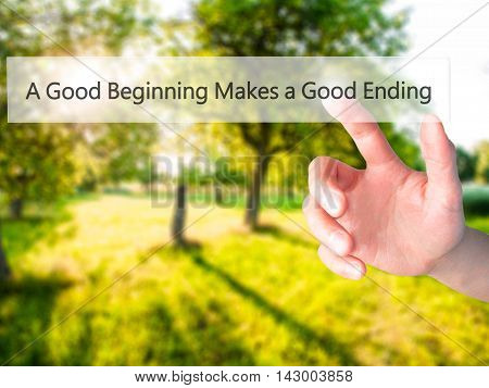 A Good Beginning Makes A Good Ending - Hand Pressing A Button On Blurred Background Concept On Visua