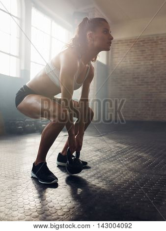 Fitness Woman Working Out With Kettle Bell