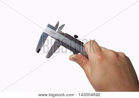 Female hand holding a caliper over white background