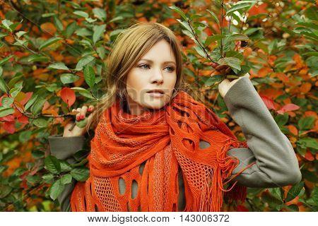 Beautiful woman in autumn foliage fashion portrait