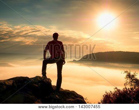 Tourist On Cliff  In Rock Empires Watch Over Creamy Mist