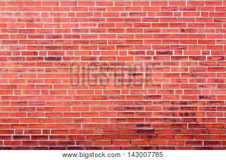 Bright Red Brick Wall Background With Dark Stains