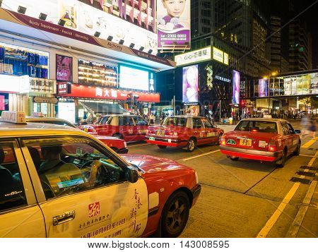 HONG KONG CHINA - OCT 22: Crowded street view at night on October 22 2015 in Hong Kong China. With 7M population and land mass of 1104 sq km it is one of the most dense areas in the world.