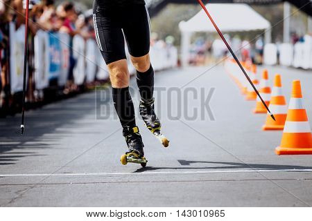 finish athlete man in ski-skaters during competition