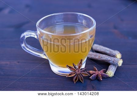 Herbal tea with star anise and licorice on a wooden table