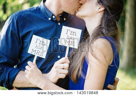 Happy loving couple kissing outdoor, love concept