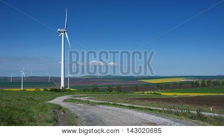 Wind turbines in mid spring at Agighiol commune, Tulcea county, Romania