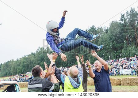 GRODNO BELARUS - AUG 13: The winner of the battle celebrates the victory on Car fighting for survival on August 13 2016 in Grodno Belarus