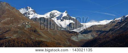 Landscape in Zermatt. Findelgletscher. Snow capped mountains Mt Adlerhorn Mt Strahlhorn and Mt Rimpischhorn.