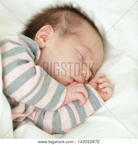 Cute baby sleeping newborn on white background (up to 1 month)