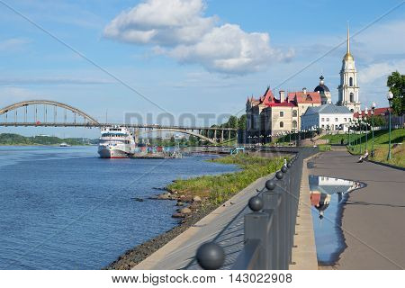 RYBINSK, RUSSIA - JULY 11, 2015: Reflection of the bell tower of the Spaso-Preobrazhensky Cathedral in a puddle on the Volga embankment. Historical landmark of the city Rybinsk, Yaroslavl region
