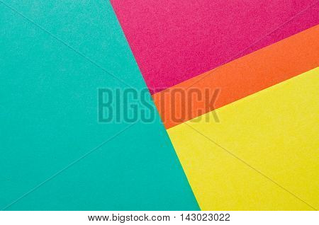 Colorful sheets of color paper abstract background