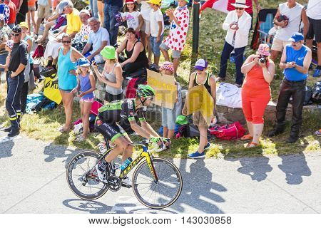 Col du Glandon France - July 23 2015: The French cyclist Pierre-Luc Perichon of Bretagne-Seche Environnement Team riding in a beautiful curve at Col du Glandon in Alps during the stage 18 of Le Tour de France 2015.