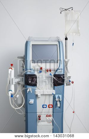 Hemodialysis machine with tubing and installations. Health care blood purification kidney failure transplantation medical equipment concept.