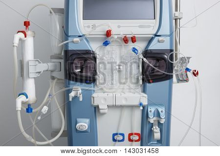 Closeup of hemodialysis machine with tubing and installations. Health care blood purification kidney failure transplantation medical equipment concept.