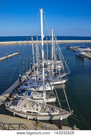 BARCELONA SPAIN - JULY 3 2016: The marina Port Forum in the north of Barcelona where lots of ships are moored.