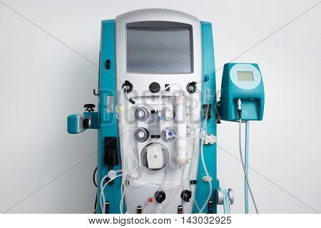 Hemodialysis machine with tubing and installations. Health care blood purification kidney failure transplantation medical equipment concept with copy space.