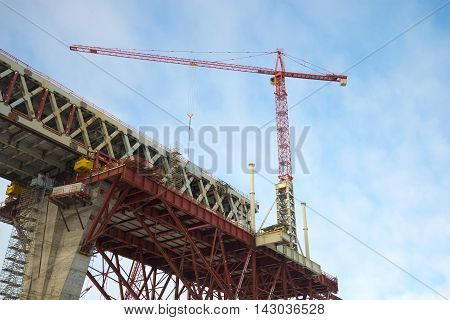 ST. PETERSBURG, RUSSIA - FEBRUARY 17, 2016: The crane on the construction of the Central section of Western high-speed diameter, february day. Saint Petersburg