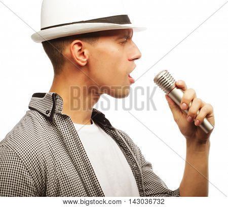 young handsome man singing with microphone