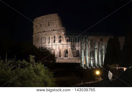 Unusual night view of the famous monument taken from the side of the Roman Forum.
