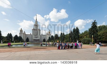 Moscow - August 11 2016: Moscow State University named after Lomonosov on the Sparrow Hills the park and tourists are photographed August 11 2016 Moscow Russia