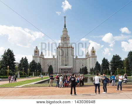 Moscow - August 11 2016: Moscow State University named after Lomonosov on the Sparrow Hills and a lot of tourists in good weather August 11 2016 Moscow Russia