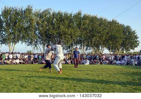 Istanbul Turkey - July 31 2016: in zeytinburnu district of Istanbul Turkmen wrestling held in the coastal meadows. Turkmen Uzbek Afghan Turkish are competing in the youth wrestling Zeytinburnu meadow.