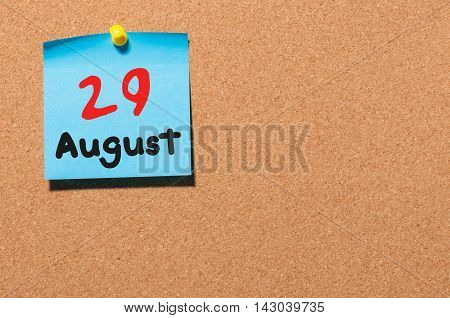 August 29th. Day 29 of month, color sticker calendar on notice board. Summer time. Empty space for text.
