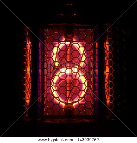 The real Nixie tube indicator of the numbers of retro style. Indicator glow with a magical purple fringing. Digit 8