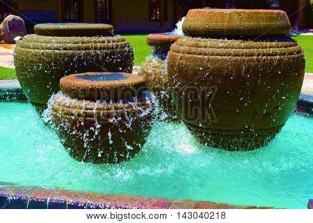 Water fountain with running water taken in a courtyard garden
