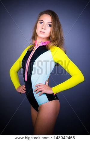 Sport girl posing on black background . Close-up