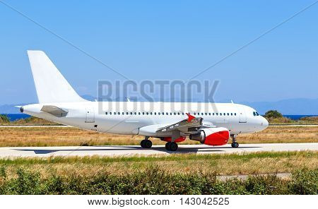 airplane on airport Rhodes island Greece, sunny summer day