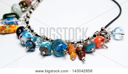 Necklace with multi-colored glass beads on white background