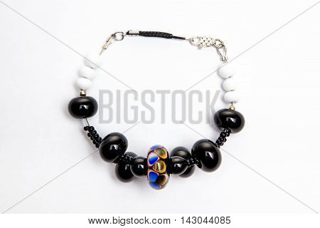 Bijouterie with black glass beads on white background
