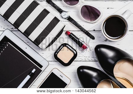 Overhead view of essential items for business women