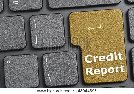 Golden credit report key on keyboard