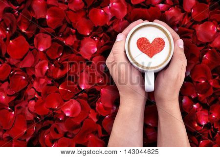 man holding hot cup of milk on red rose petals background with red heart shape holiday valentine day love concept